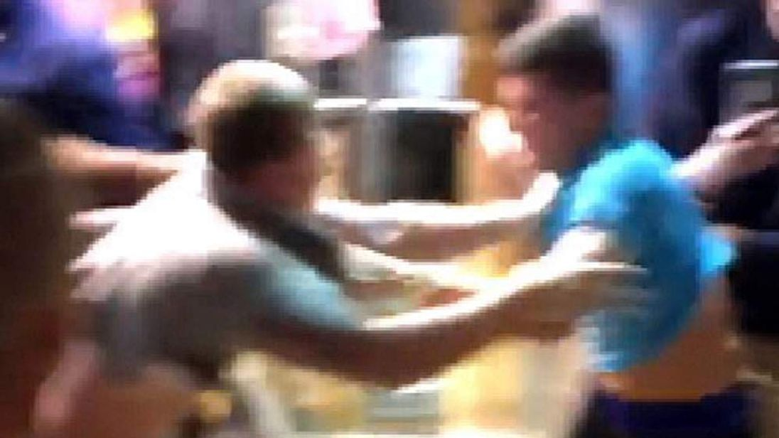 Two men brawl in the food court of a Kentucky mall during Black Friday