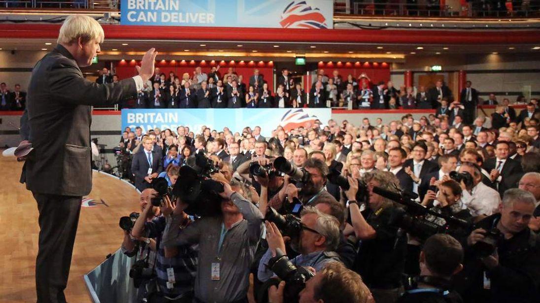 Boris Johnson leaving the stage