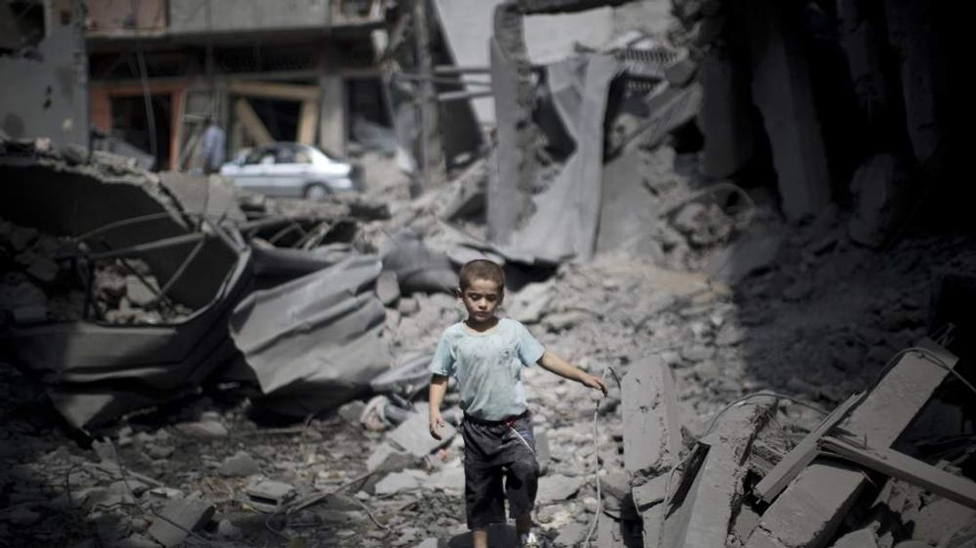 A boy surrounded by rubble in Gaza