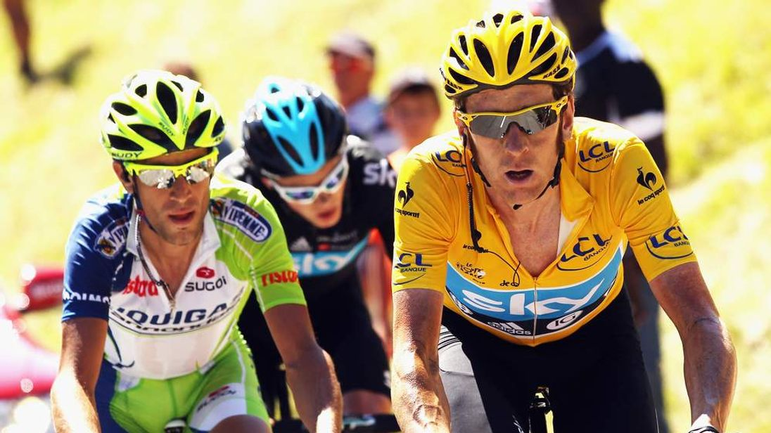 Bradley Wiggins, right , and Chris Froome of Britain.