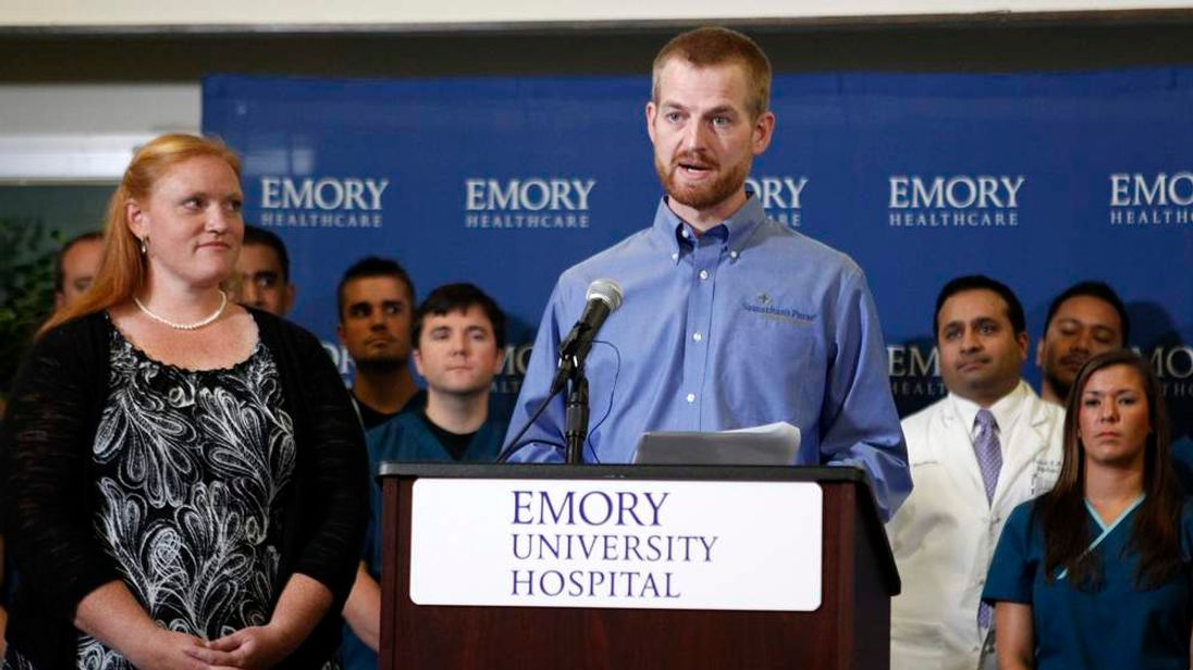 Dr Kent Brantly with his wife Amber at Emory University Hospital in Atlanta