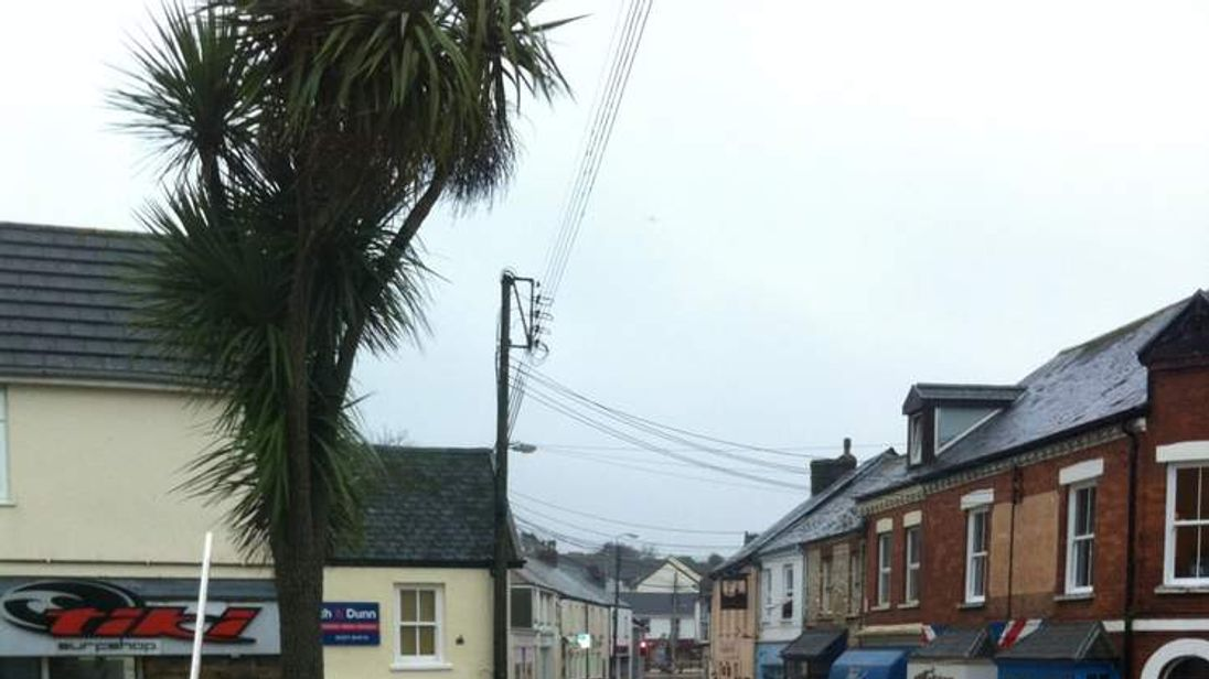 Shops lining a flooded street in Braunton in Devon