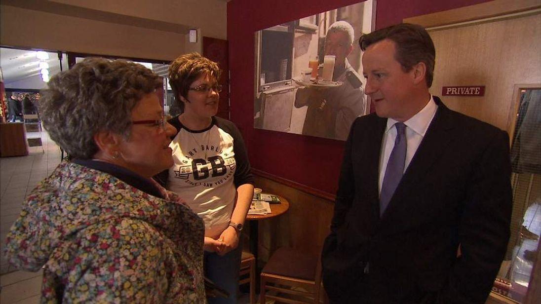 David Cameron speaks to Gary Barlow fans