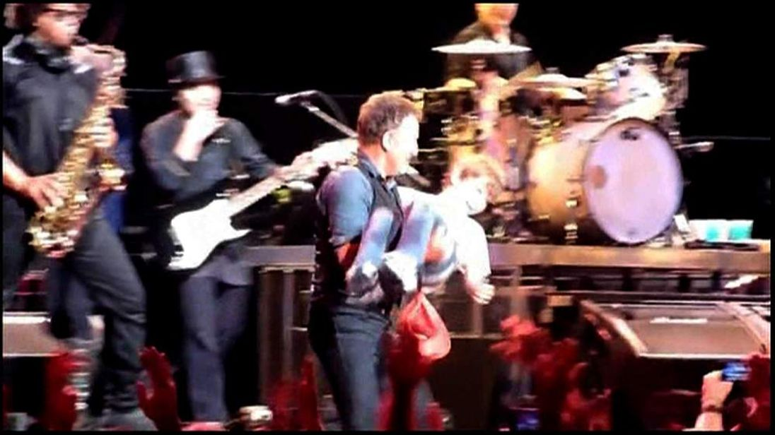 Boy on stage with Bruce Springsteen