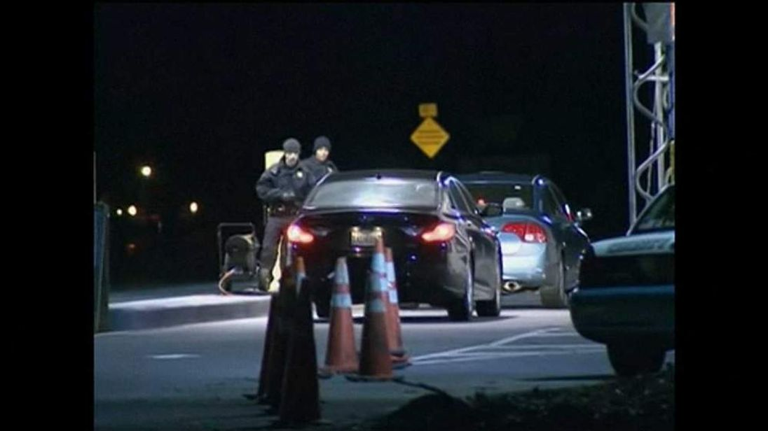 Armed guards at entrance following shooting at US Marine Base Quantico, in Virginia