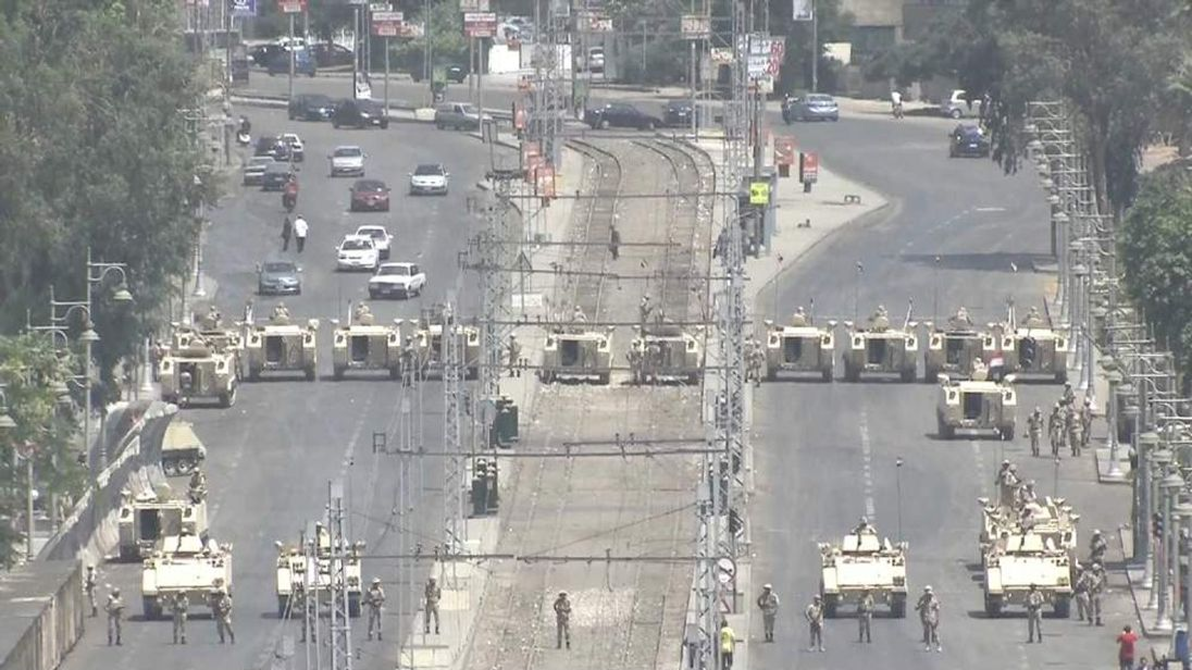 The Egyptian army move tanks into position outside the presidential palace