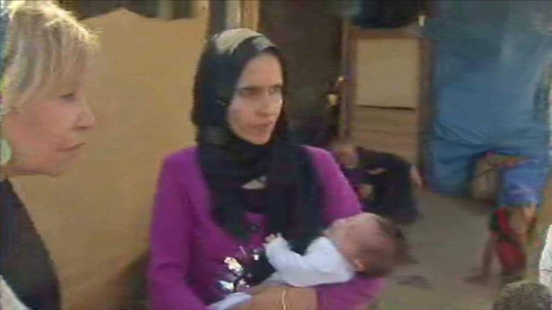 Syrian refugee Mona Khaled and baby Boutoul in Lebanon