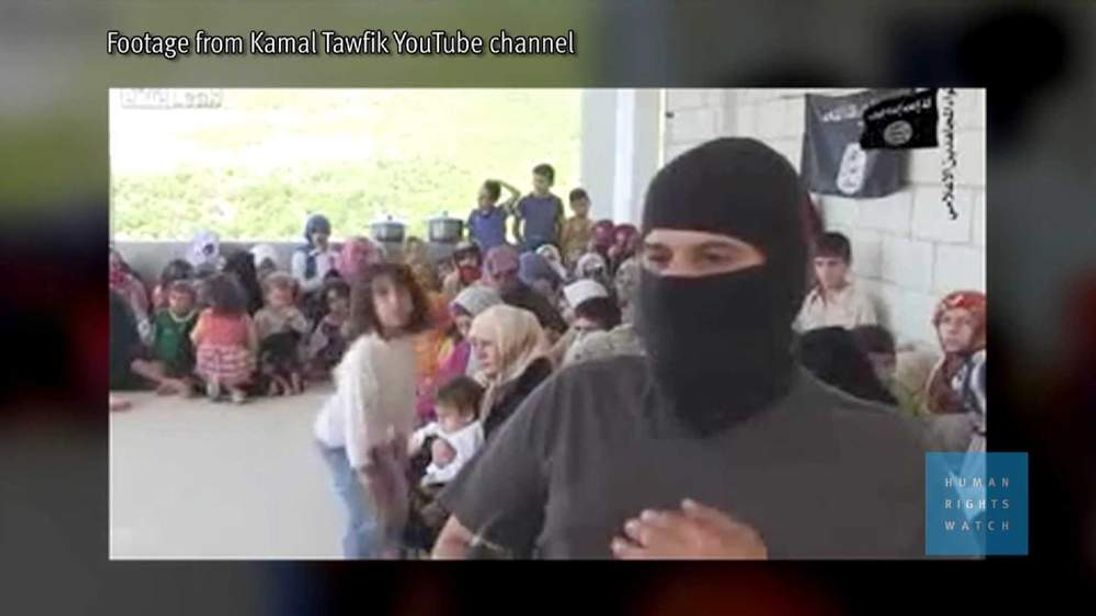 A hostage taker with children in the background