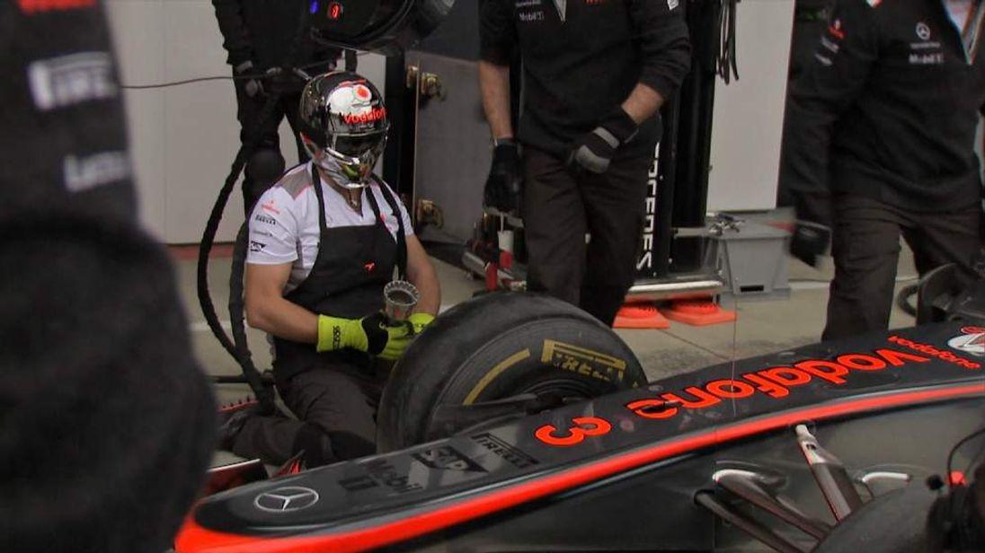 McLaren car and engineers