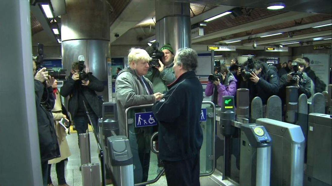 London Mayor Boris Johnson with non-striking tube worker