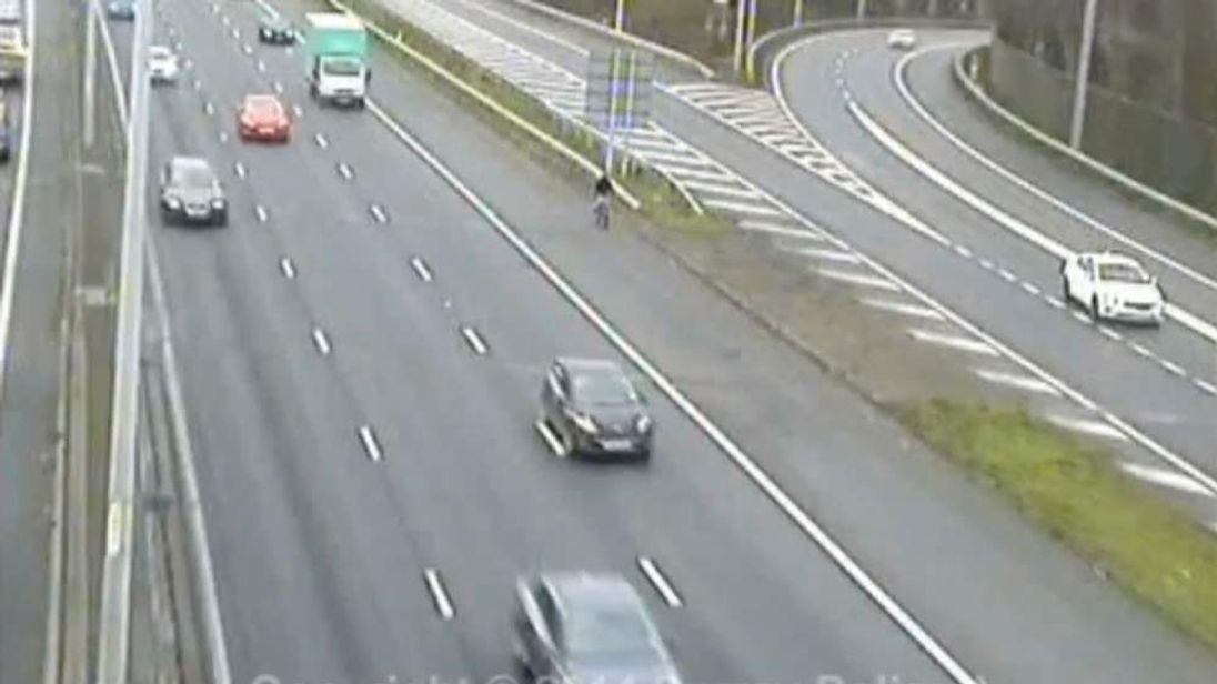 Cyclist rides along M25 as a shortcut
