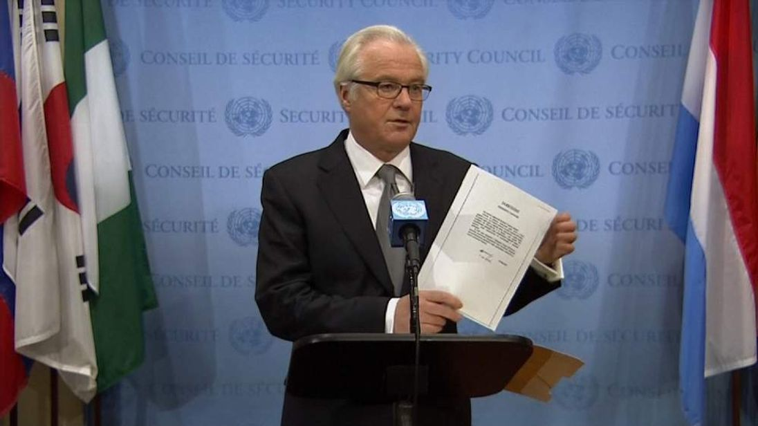 The Russian ambassador to the UN holds up the letter