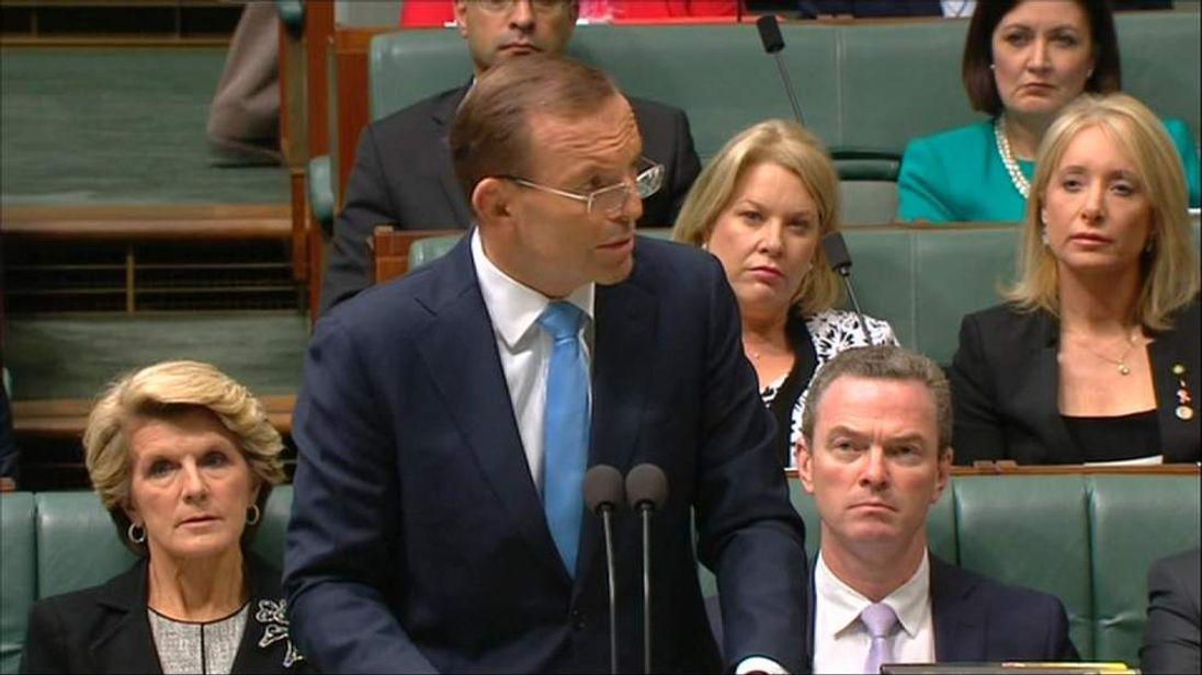 Australian Prime Minister Tony Abbott briefs MPs