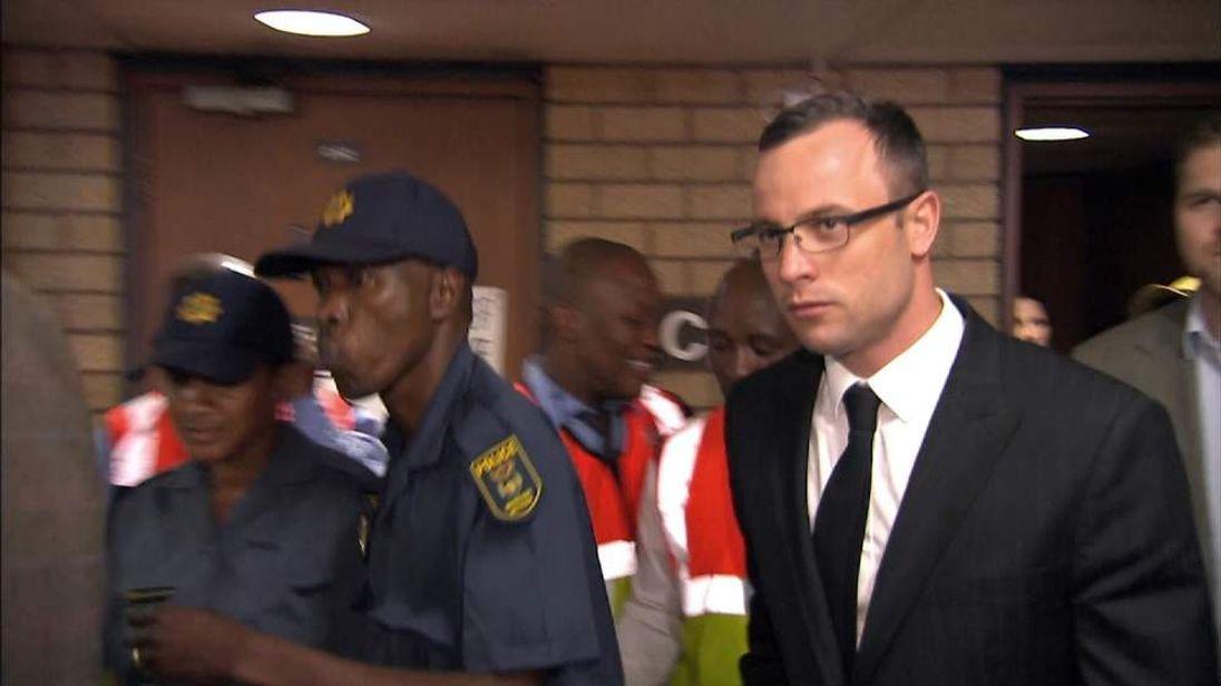Oscar Pistorius leaves court.