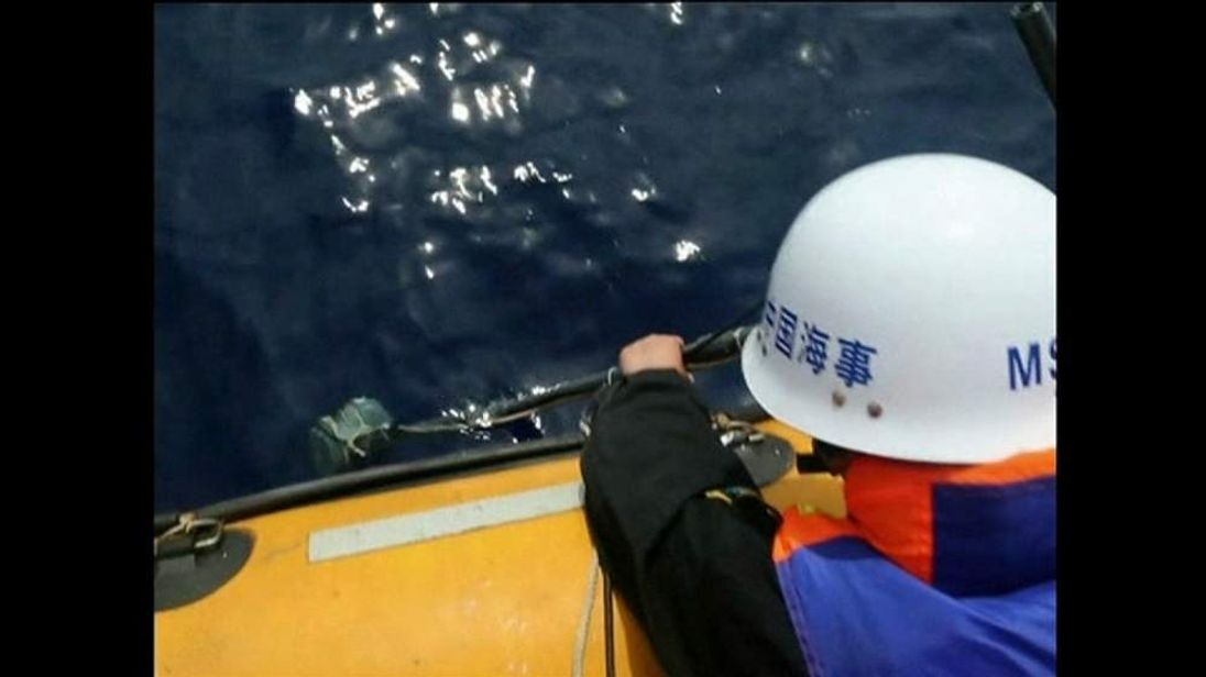 A member of a Chinese search team listens for acoustic signals in the hunt for flight MH370.