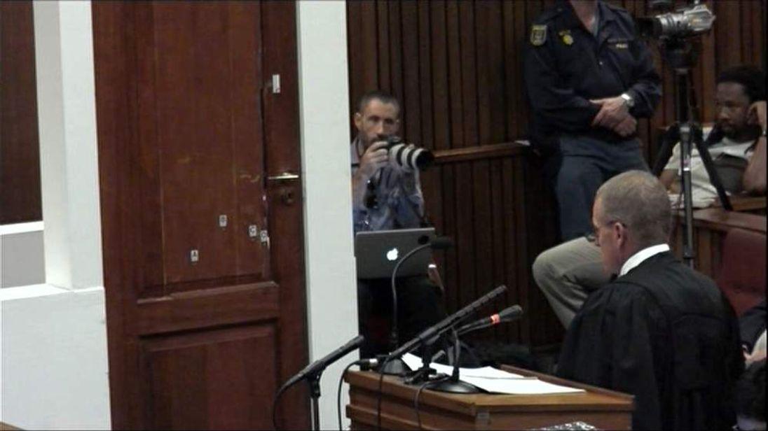 Pistorius describes opening the bathroom door to get to Reeva
