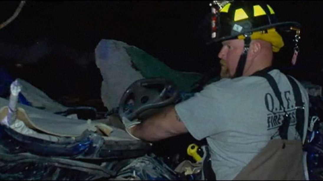 Firefighters begin clearing up after a tornado in Arkansas