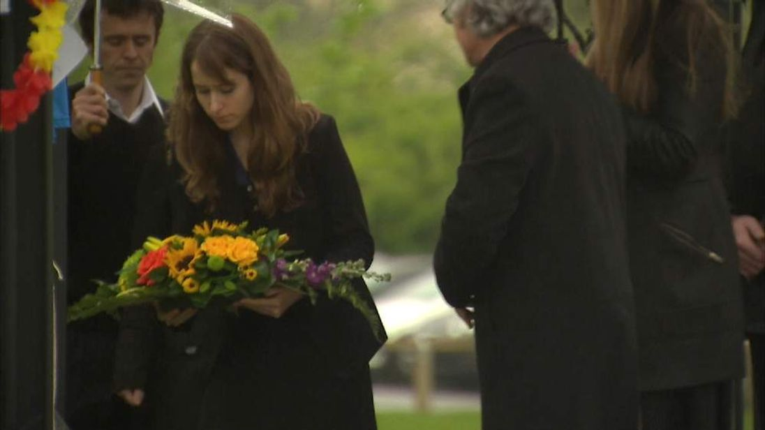 The family of Ann Maguire lay flowers