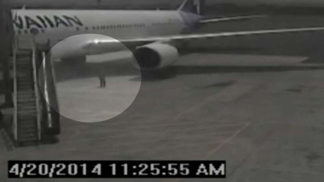 CCTV of stowaway emerging from a plane in Hawaii