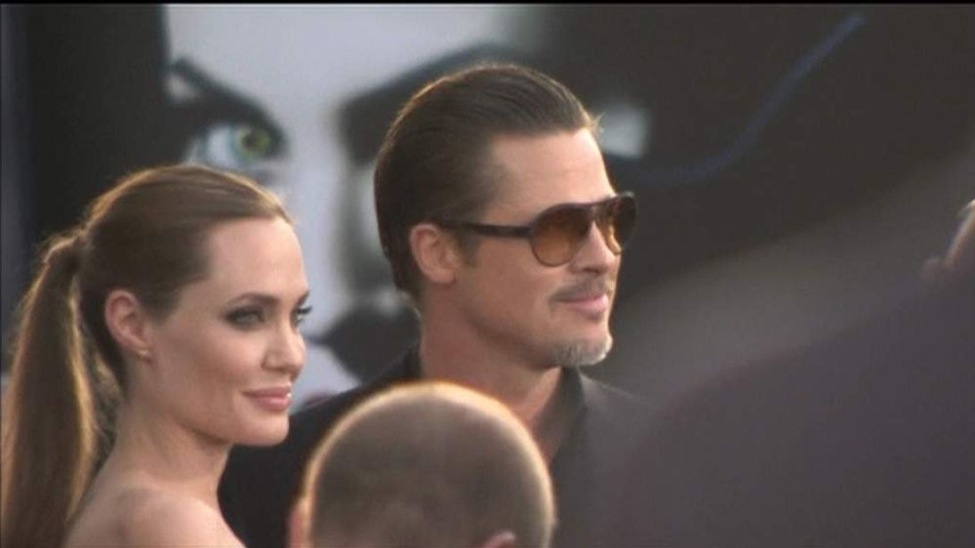 Brad Pitt and Angelina Jolie on red carpet for Maleficent