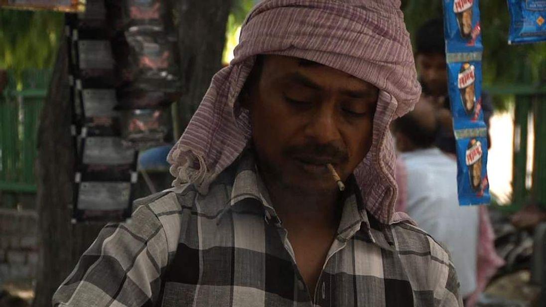A man smoking in India.