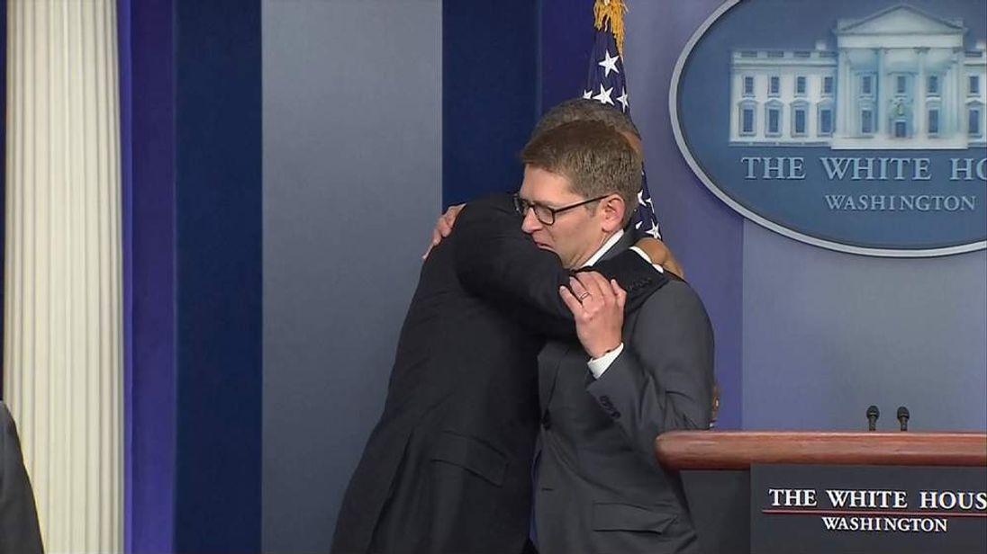 US President Barack Obama and Jay Carney hug