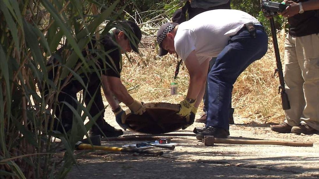 Police search an area of scrubland in Praia da Luz for any clues about Madeleine McCann's disappearance