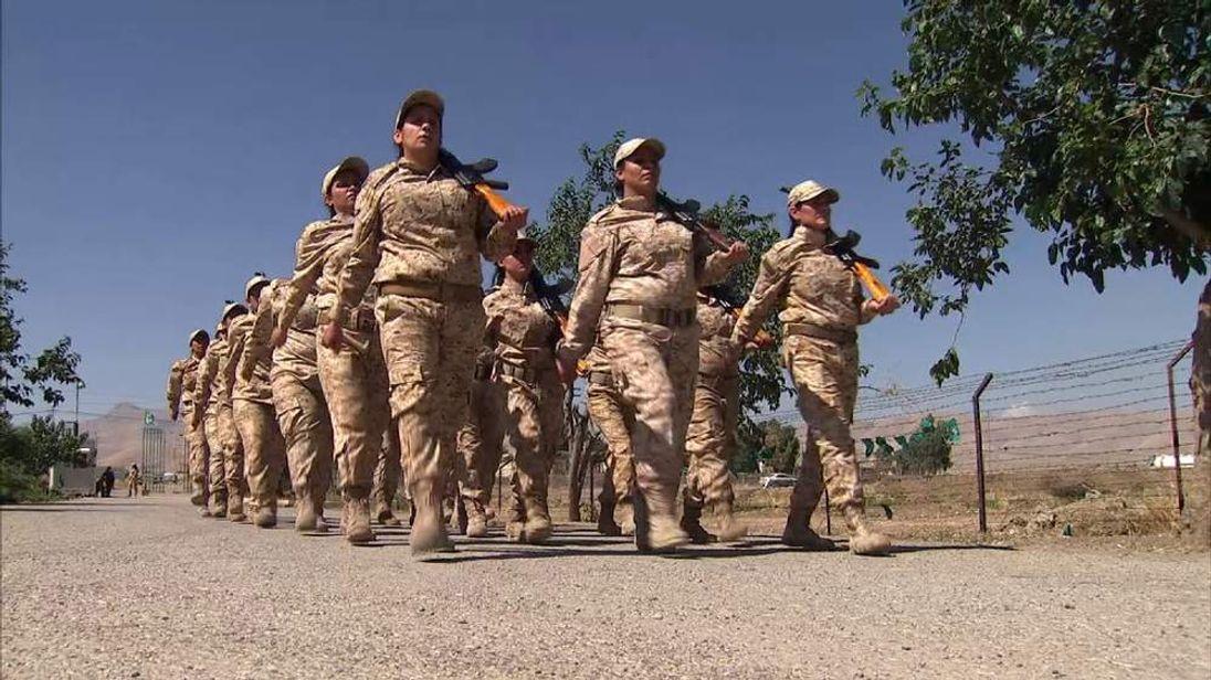 Female Kurdish Peshmerga fighters march at their mountain base