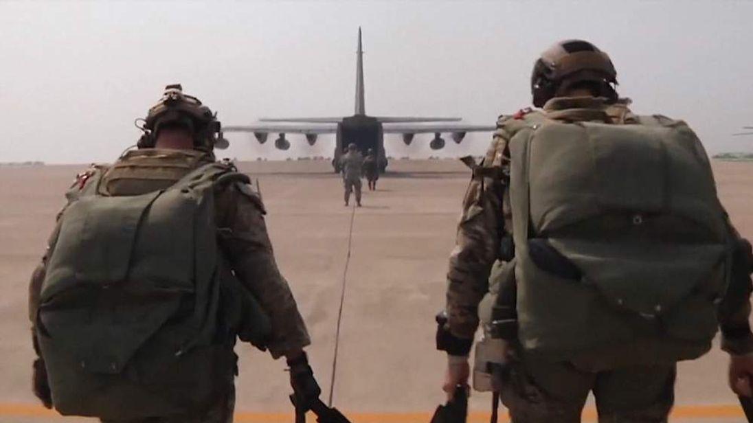 US Troops Walking Toward Military Aircraft