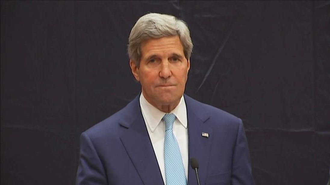 US Secretary of State John Kerry addresses journalists in Cairo
