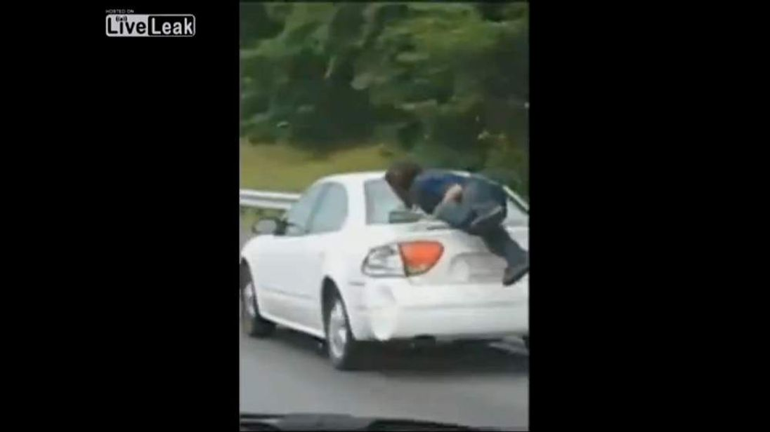 North Carolina man clings to car