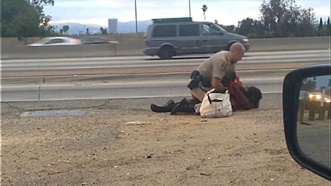 Policeman hitting woman