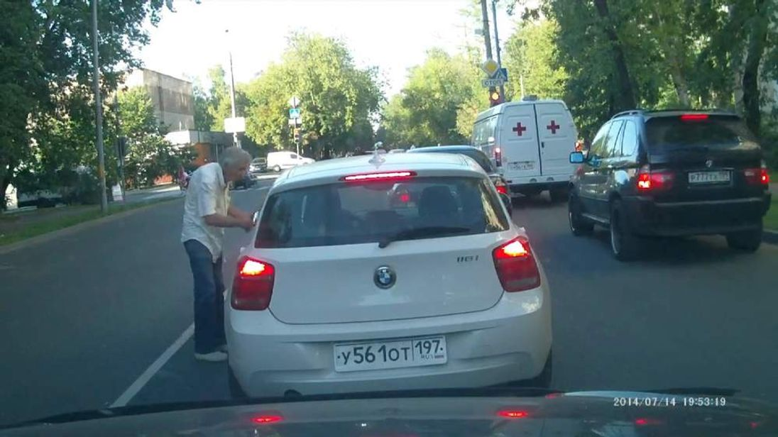 The driver talks to the other motorists before the road rage incident