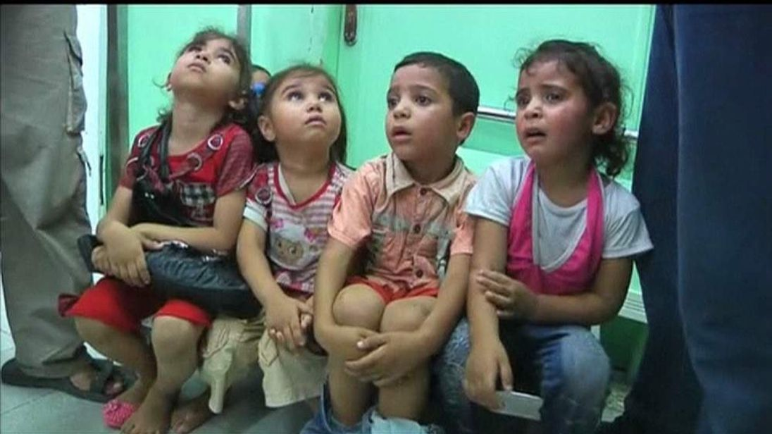 Palestinian Children Sitting In Hospital After UN School Shelled By Israeli Forces