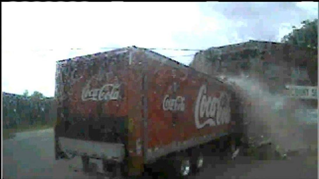 A Coca-Cola truck crashes into a shop in Jacksonville, Florida
