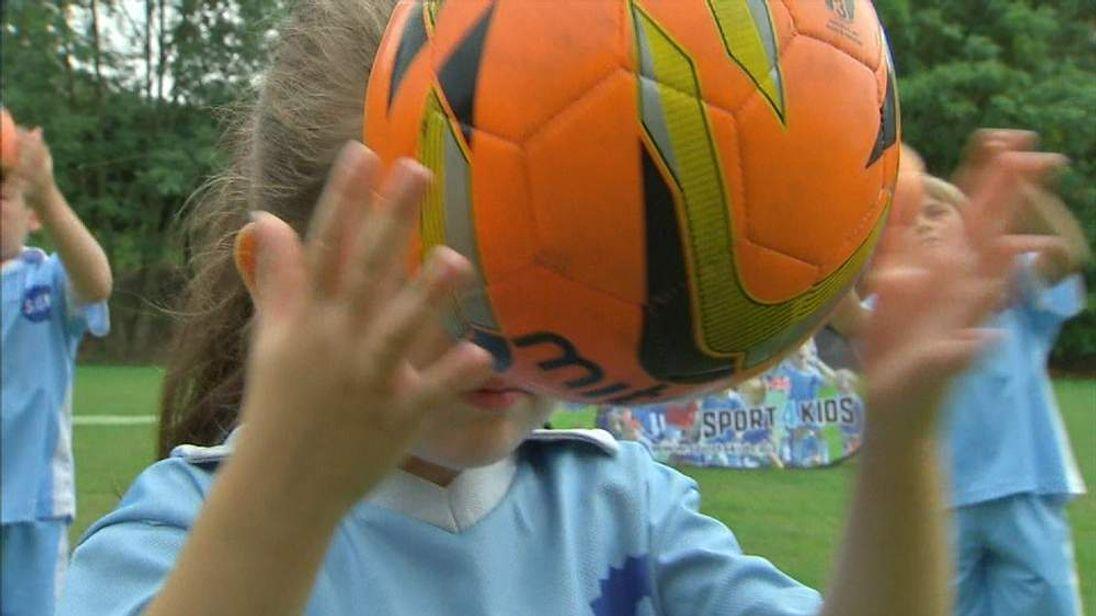 Children heading a football