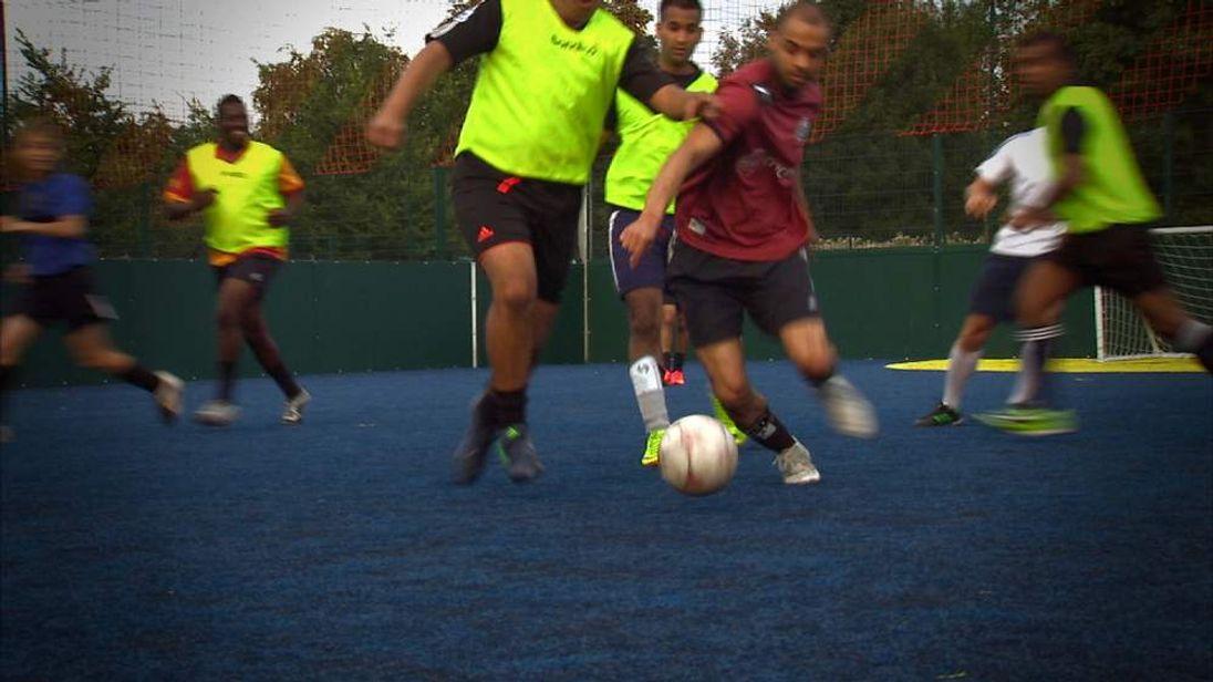 Young British-Asian men playing football 2