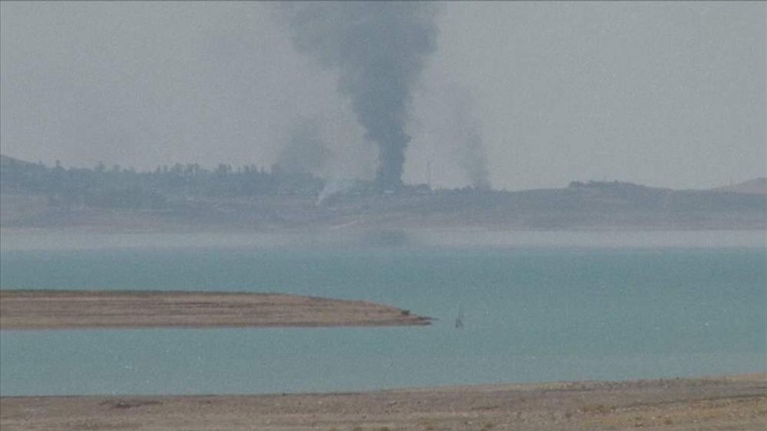 Smoke rises from an area close to Iraq's Mosul dam