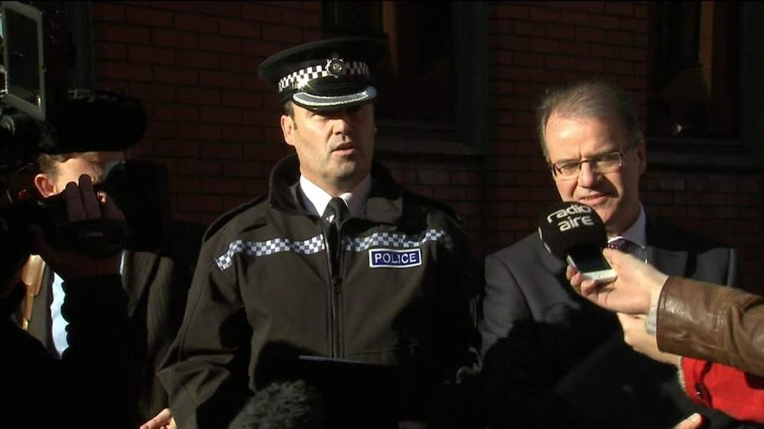 Police give a statement outside court
