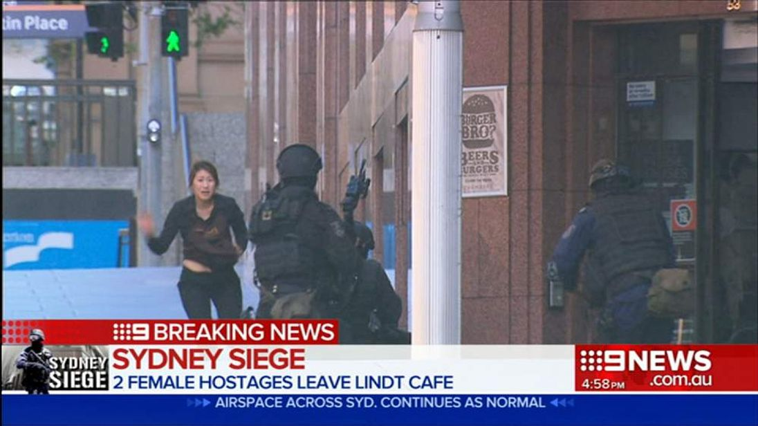 Woman flees Sydney Siege building