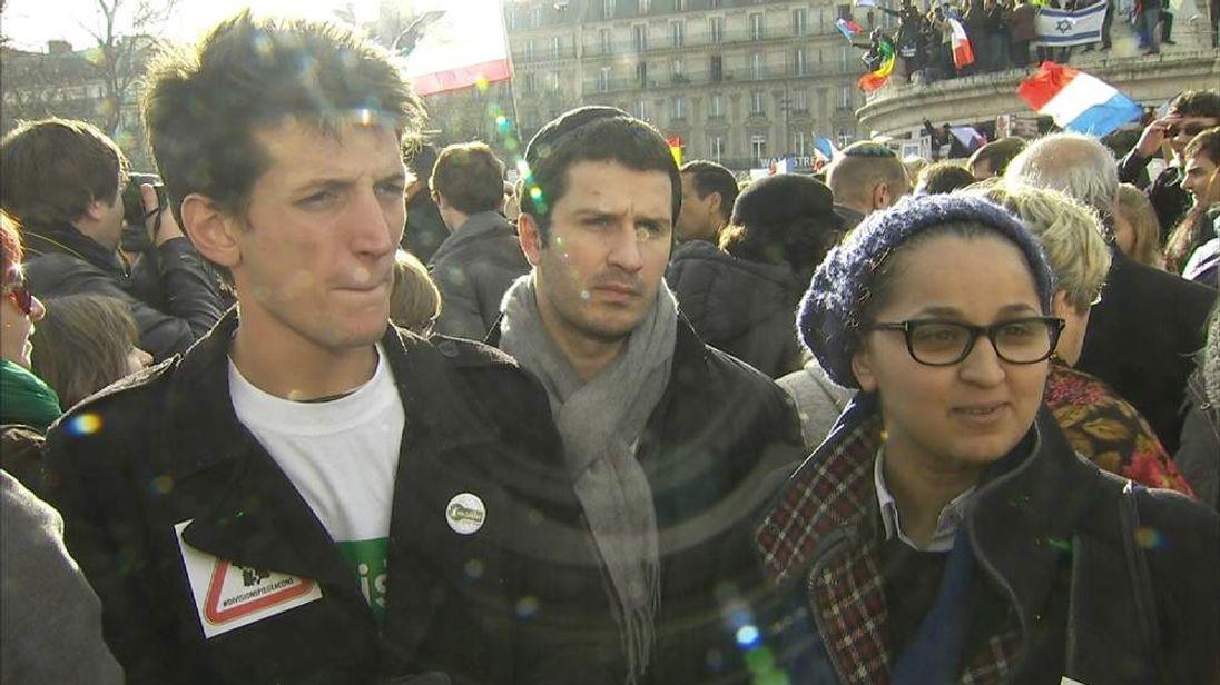 Three activists at march at the Place de la Republique