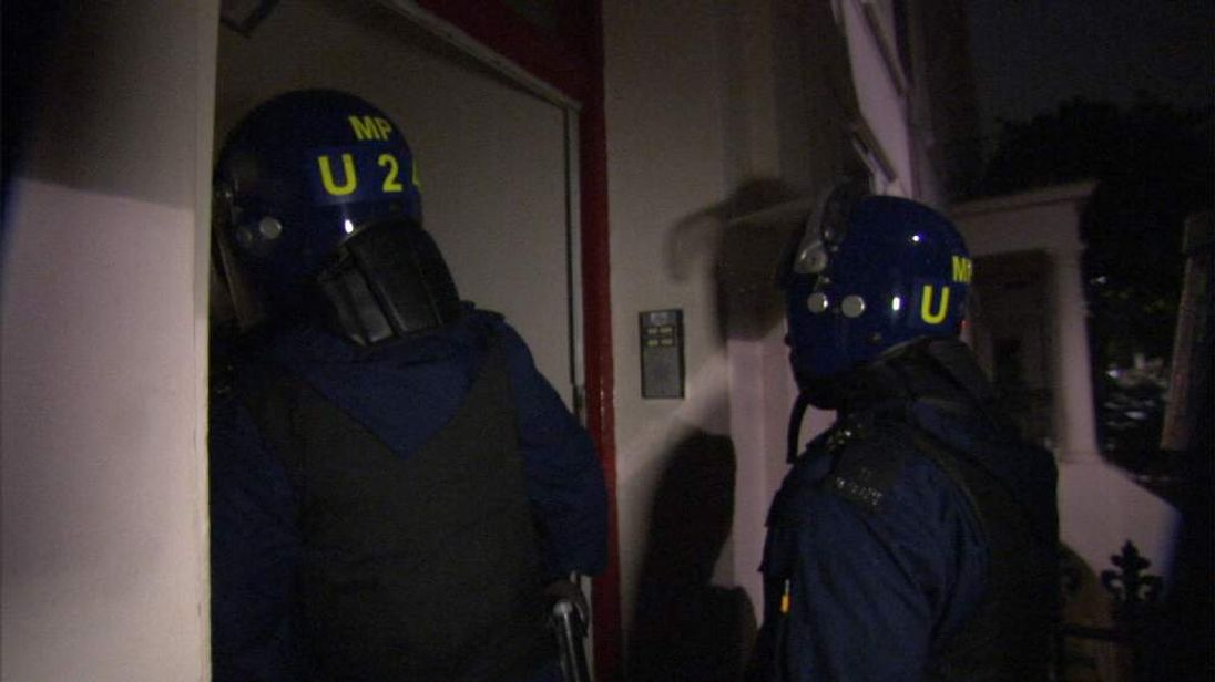 Police raid a property in London