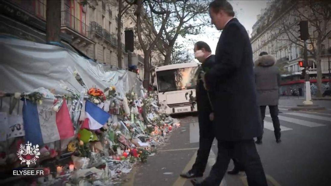 Cameron and Hollande Lay Roses At Bataclan Memorial