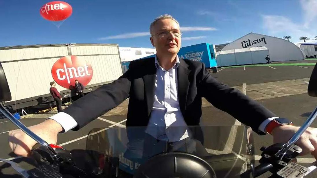 Sky's Martin Stanford rides the Genzi electric scooter at CES in Las Vegas