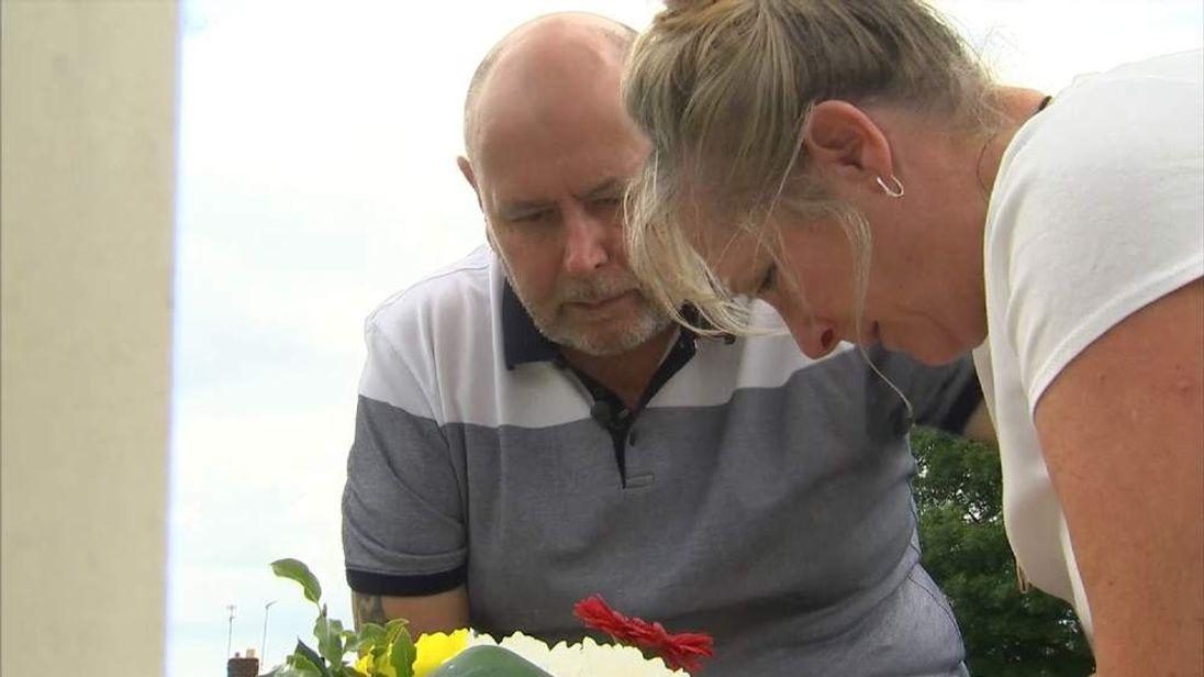 Simon and Marilyn Miller at their son Corporal Simon Miller's grave