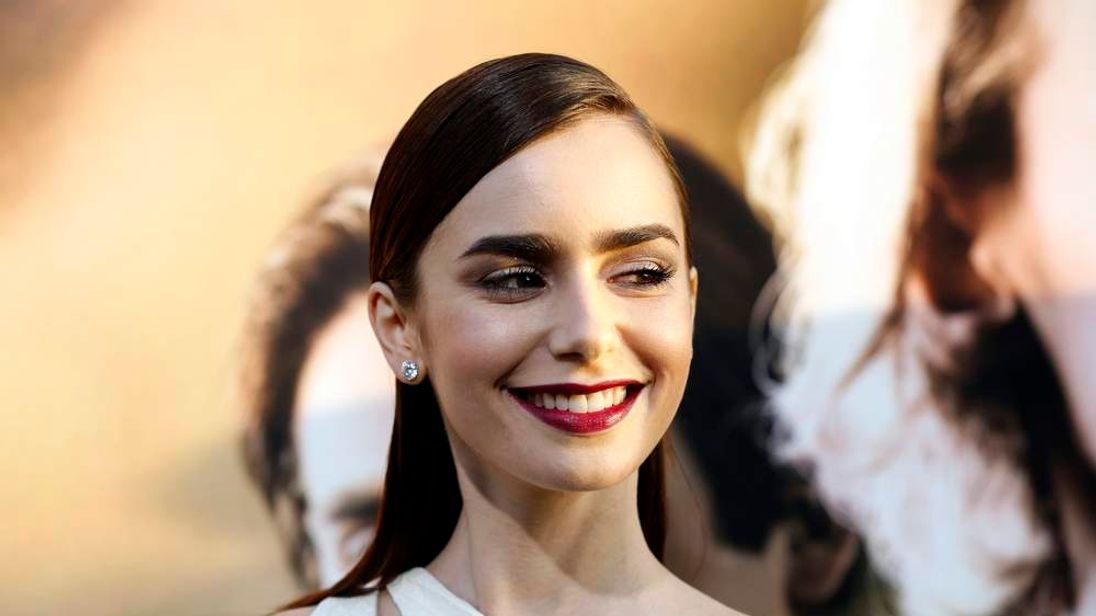 """Lily Collins poses at the premiere of """"The Mortal Instruments: City of Bones"""" in Los Angeles"""