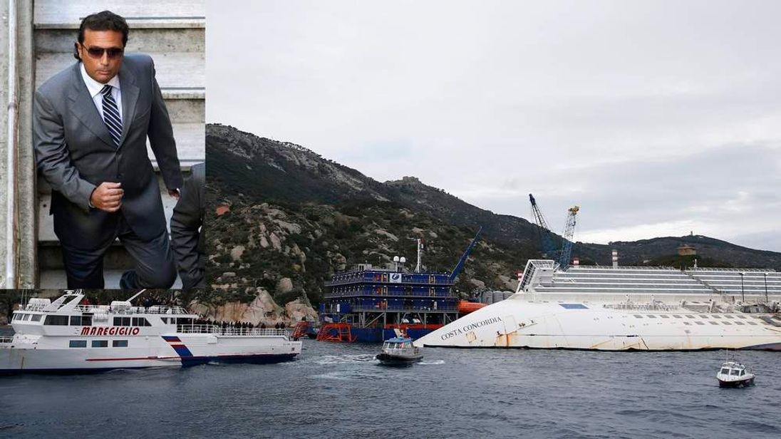 Relatives of victims stand on a ferry during a ceremony to commemorate the first anniversary of the Costa Concordia shipwreck outside Giglio harbour