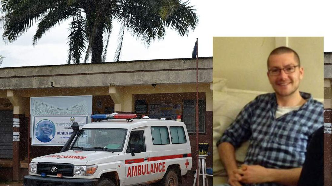 William Pooley and An ambulance is parked in front of the Kenema government hospital, in Sierra Leone