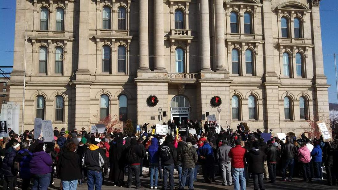 Protesters gathered in front of the of the Jefferson County Courthouse in Steubenville