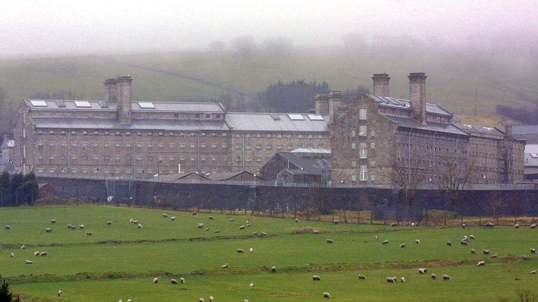 Fog hangs over Dartmoor prison and the sheep grazi